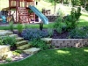Natural stone wall and practical stairways only add to the kids' fun and climbing!