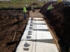 We have started using a very heavy-duty big-block retaining wall system for tough, tight site situations.